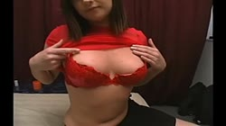 Pink nips in red bra, white cum on pale face.