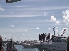 going boat to boat talking girls into flashing their tits